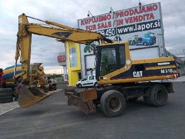 Bager NEW HOLLAND MH 5.6, BJ 2006